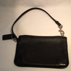 Coach leather wristlet in excellent condition.